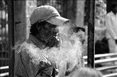A man smoking at the Mumbai train station.: by kerrinsheldon, Views[262]