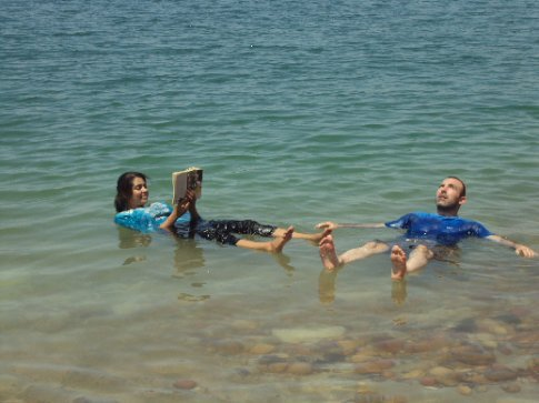 reading a book in the dead sea - best feeling ever