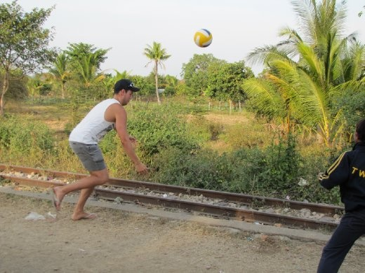 playing volleyball with local kids