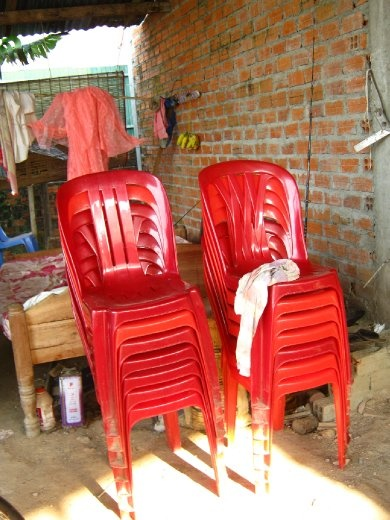 red chairs that are everywhere in cambodia