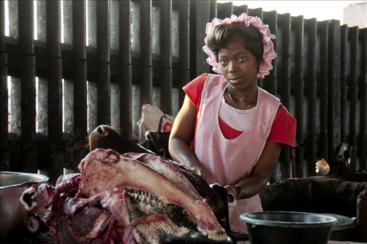 Meat Market Trader prepares goods before opening for trade.