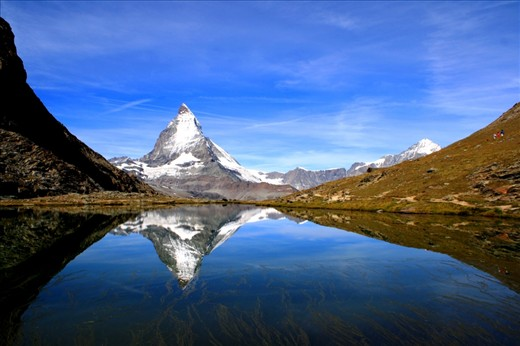 Matterhorn as relflected in a lake, July 13, 2011. To take this photo, I needed to stay and wait here for one hour till the wind has completely stopped.