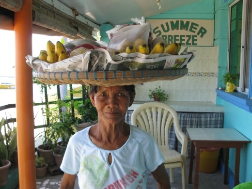 lady who sold us fruit every morning- very heavy basket!
