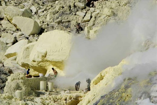 Risking diseases of the lungs, heart and eyes, miners extract pure sulphur as it emerges in molten form from deep within the crater