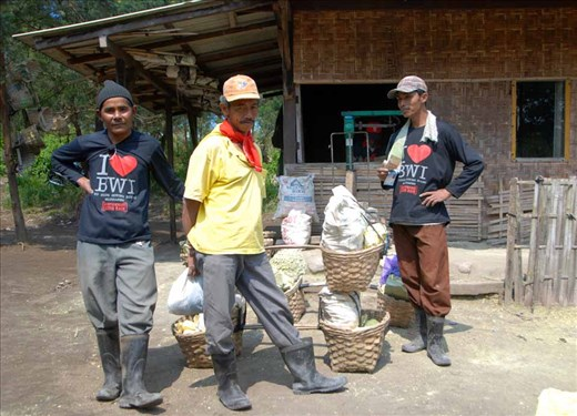 These men have completed their second (and final) trip for the day to the crater and back, and now receive their wages in cash – approximately 60 cents (US) per kilogram, for an average US$48 per 12km return trip.  A fortune in a society where the minimum wage is around US$100 per month, but at a huge health cost.