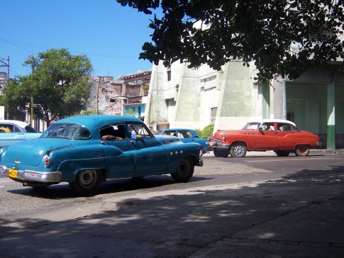 Red 1951 Buick and blue 1953 Buick