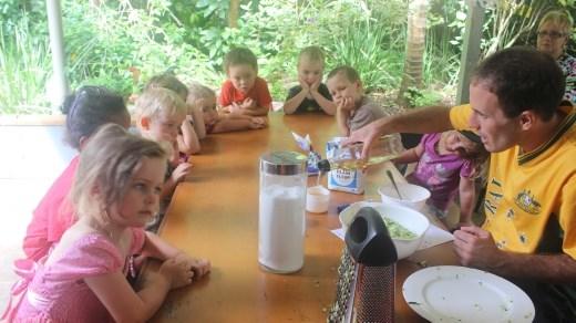 The kids are enjoying preparing zucchini bread