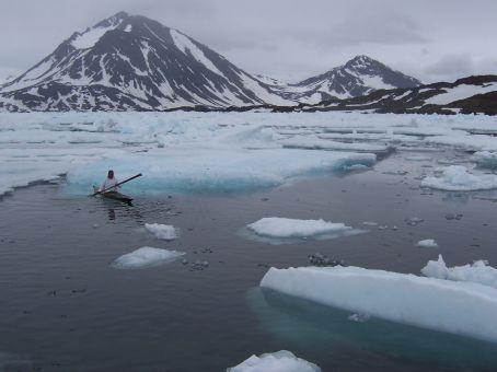 Pele paddles his kayak gracefully