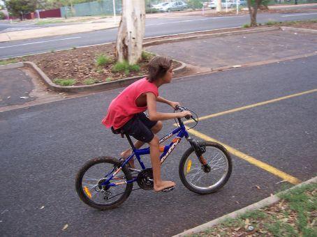 Aboriginal boy riding his bike