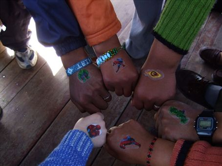 SB sharing his spiderman tatoos with his new Peruvian friends on a boat on Lake Titicaca, Bolivia