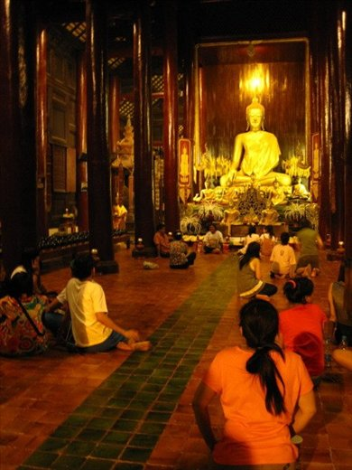 many gather to ask Buddha for good luck in the New Year