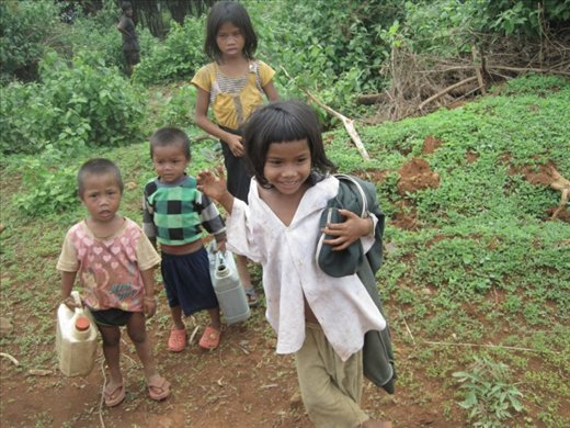 village children going to work in the fields with their father