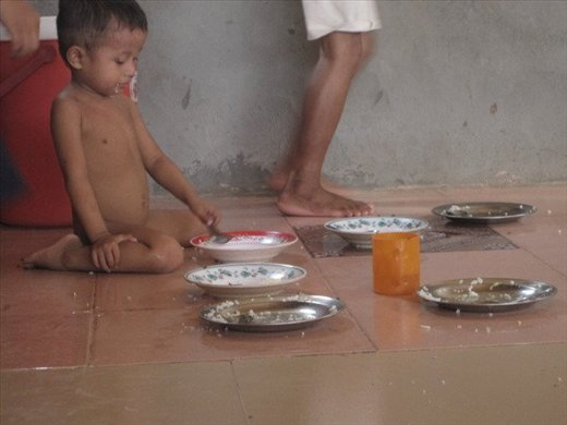 lunch time at the orphanage, usually rice, greens, and fish