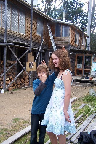 Host 4 kids: Elle (13) and Benn (9) in front of the house