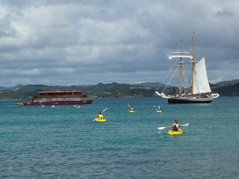 The Rock and the R Tucker Thompson sailing ship with our kayakers returning