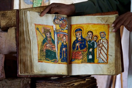 300 yr old Marian stories book held by priest in Yeha