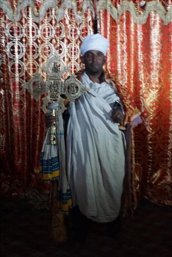 priest with Lalibela Cross