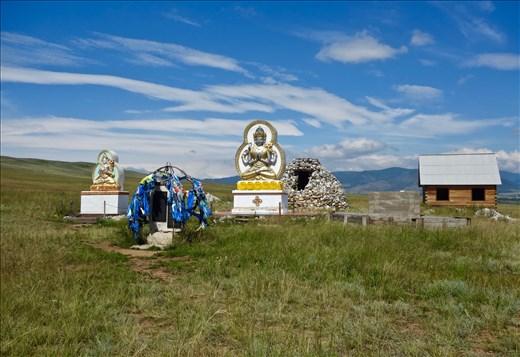 Atsagat Monastery field with shrines and copy Milarepa cave