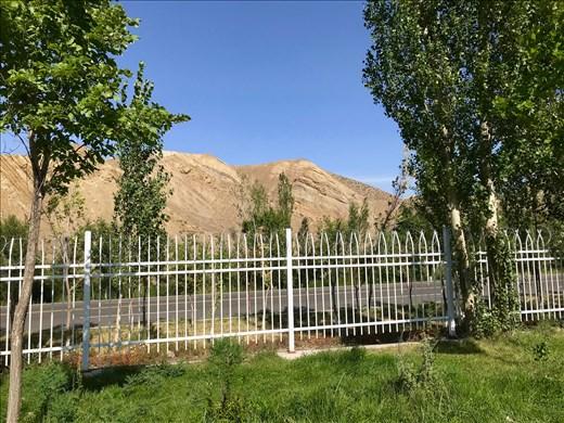 Barren desert hills behind irrigation areas