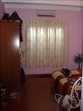 My hideous pink bedroom!  Now, the sheets on the bed cost a fortune, but they were the only bed sheets to be found that don't have flowers, puppies or words like