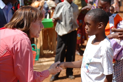 The Agreement;  Margie Braband promises a child that clean water access will soon be available in his village.