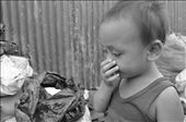 SENSE OF SMELL. People living in Payatas—even those at a very young age—are exposed  to the nasty smell of their surrounding. They have to endure and get used to the  stench, for collecting garbage is their primary livelihood. An innocent boy  covers his nose as he stares at the amount of waste outside their home.: by kurtzky, Views[540]