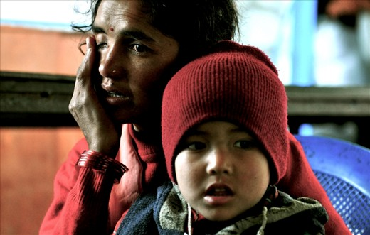 A young Nepalese mother expresses her emotion on camera about the abuse she suffers from her husband. She is forced to hide her small income and sneak out with her children in order to work and feed them.