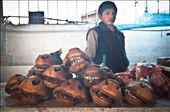 A serious young boy with Cow's mouths for sale. San Pedro Markets, Cuzco, Peru.: by laramer, Views[620]