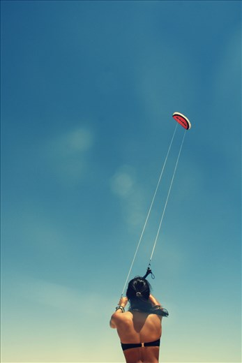 To Kite-Surf and learn an exciting water sport!