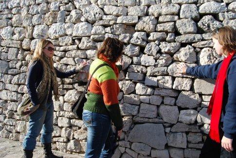 Maja the tour leader explaining dry wall.