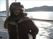 On a boat to a nearby island.  Sara looks like a muslim here.  Hey, it was cold.: by larasumera, Views[137]