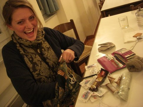 Erica cleaning her purse.  Notice all the sugar packets we've hoarded.