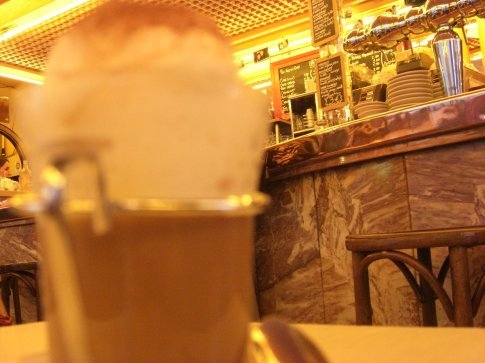 Ridiculously expensive cappaccino.  Worth it to the shameless tourist-film student in me.