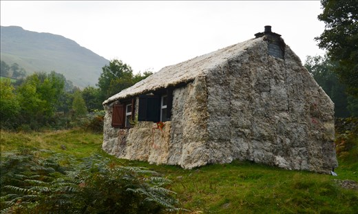 Cottage covered in sheep wool = ART?