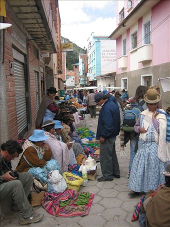 street sales in Copacabana, bolivia.. check out the bowler hats on these women!
