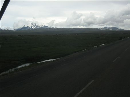 road to la paz, altiplano... snow covered andes in the distance