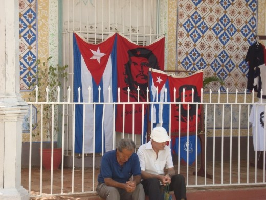 Old men sitting at a corner in Trinidad de Cuba. Elders of today were the   revolution's youths. Che's portraits can be found in every corner of Cuba as the   relentless symbol of a revolution, once youthful with high aspirations. After fifty years  do they think revolution fulfilled its promises?! Can their miens tell some answers?