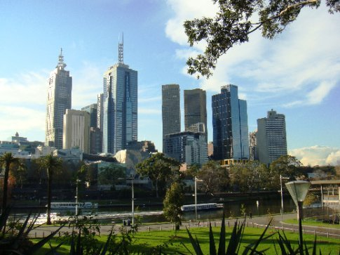 Melbourne city, with the modern Federation Square in front, from the south bank of the Yarra River.