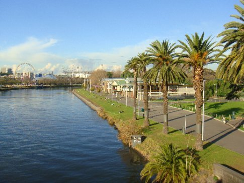 The boathouses along the south side of the Yarra River, with the Melbourne Cricket Grounds in the distance.