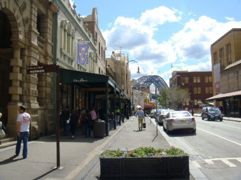 The main drag of The Rocks is George Street.