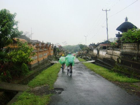 Riding through a village of family compounds