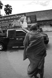 A monk weaves his way across a busy street in Chiang Mai, Thailand.: by liaferrandini, Views[177]