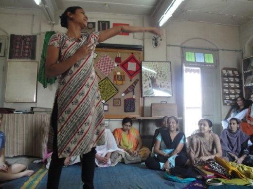 Young woman artisan dancing for us all at Design SEWA in Ahmedabad