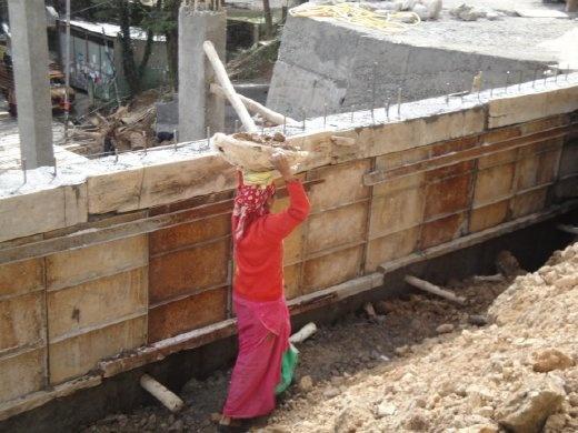 A woman construction worker   (photo: Allison Coleman)