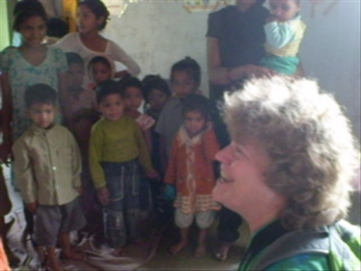 Marytha teaching a song at the SEWA daycare center  (Photo: Cheryl Weber)