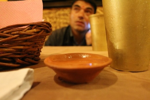 A bowl of smooth but hot local rice wine. My guide did not seem to be entertained by the performance in the restaurant.