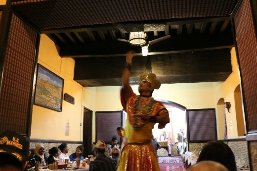 Many tourists were having a good time in the restaurant as the performance and food went on.