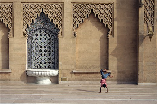 The kid found his playground near the Hasan Mosque in Rabat city
