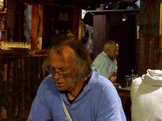 Man at dinner. When you dine alone you have plenty of time to look around..