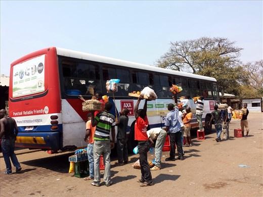 Venders selling to bus passengers